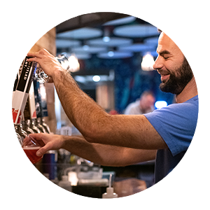 Man Pouring Beer from Tap Handles